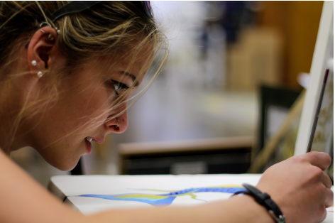 Brianna Jordan, a junior, focuses on the details in her artwork. Even capturing non-typical expressions (not joy, sadness, anger, etc.) like the concentration portrayed here is a method of telling the emotional story of the subject.