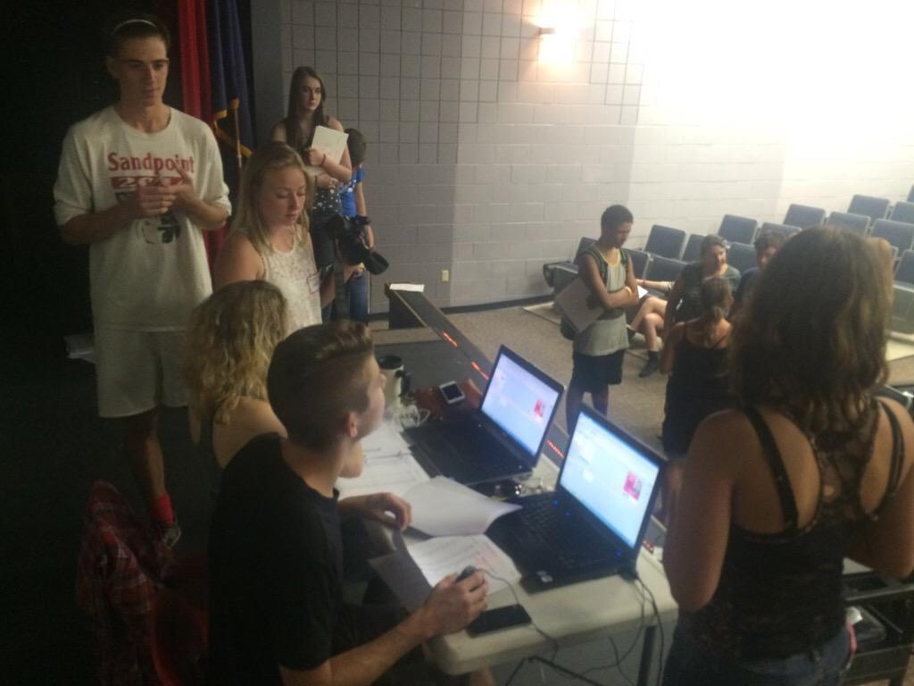Members of the Cedar Post produce student ID cards during a new-student orientation night at Sandpoint High School. This is the third year the staff has done this fundraiser.