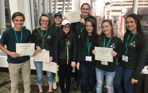 Staff from the Cedar Post gather after the JEA's awards ceremony at the National High School Journalism Convention in Seattle. The Cedar Post is a student-run news organization from Sandpoint High School.